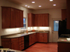 Maple cabinets, Oak floors, Recessed lights, and Under cabinet lighting.